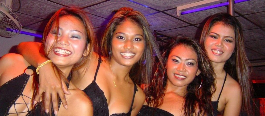 4 Pattaya Bar Girls laughing